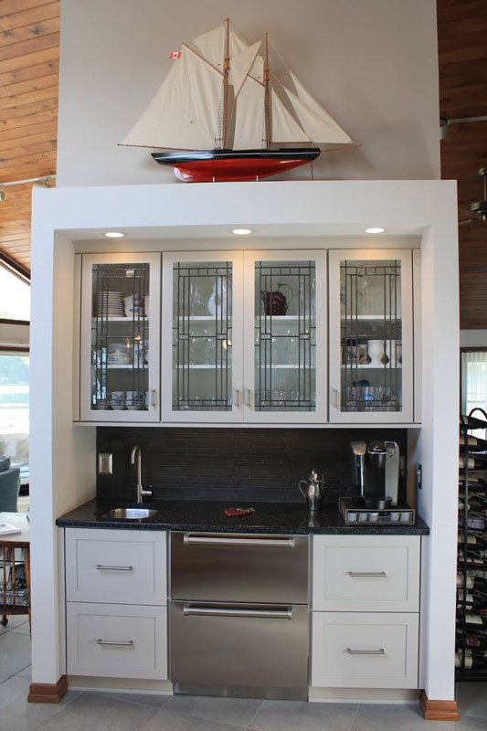 white cabinets with model boat displayed