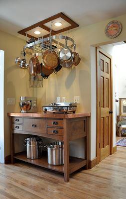 wood cabinet in corner of kitchen