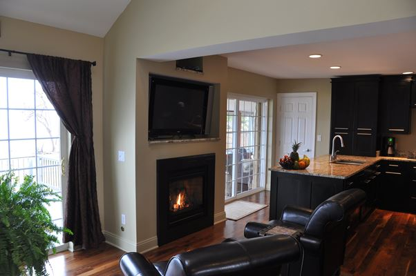 kitchen with chairs and fireplace
