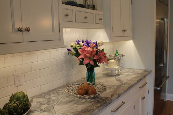 counter with flowers in vase