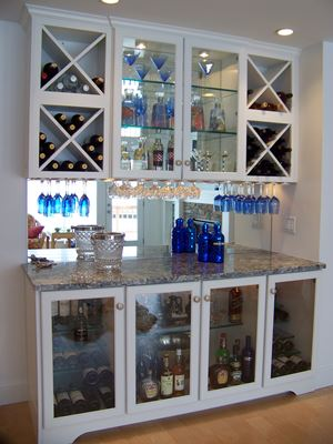 bar with wine and wine glasses in cabinet