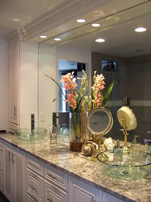 bathroom with two glass sinks